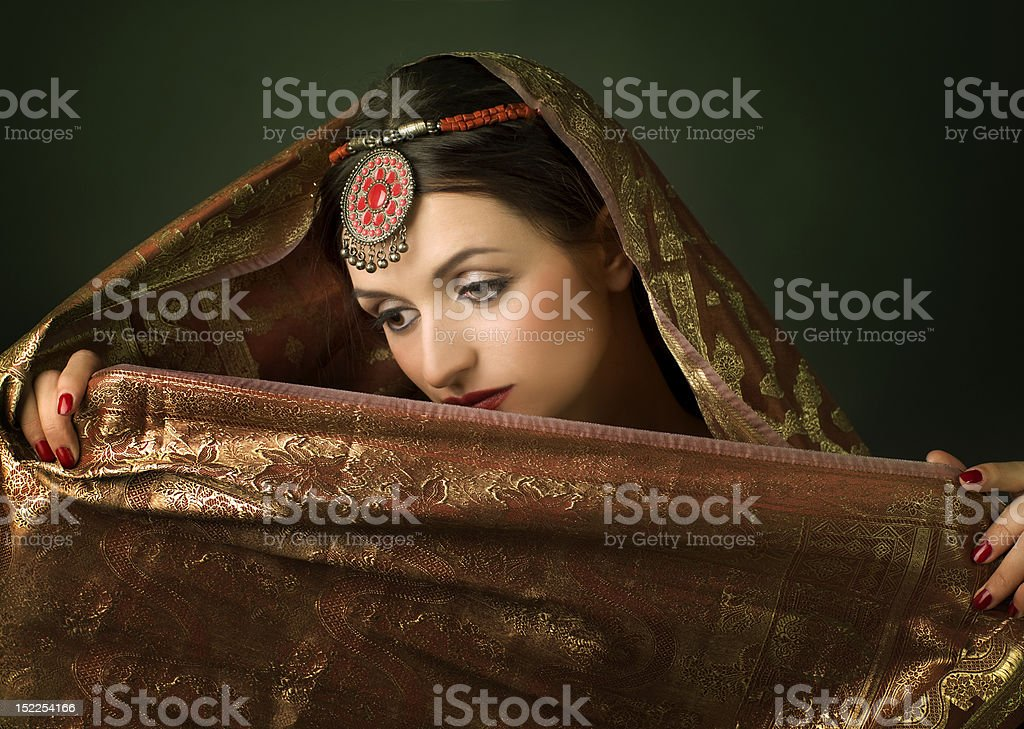 Beautiful brunette portrait with traditionl costume. Indian styl stock photo