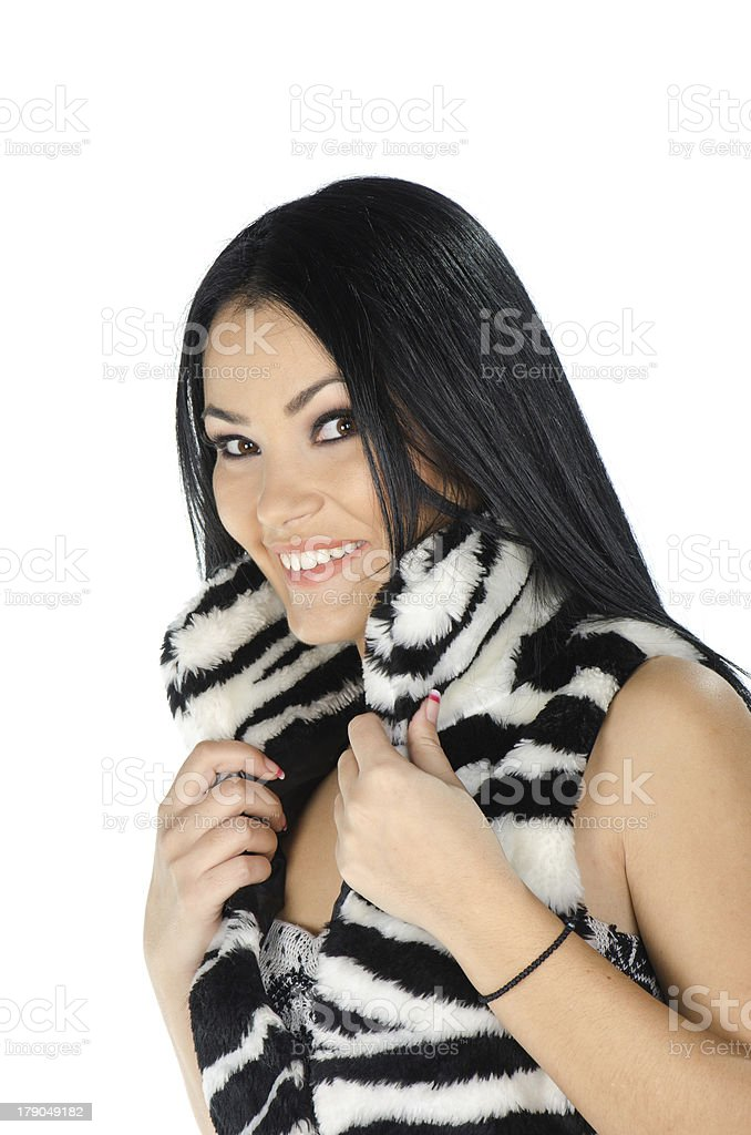 Beautiful brunette posing and showing her furry vest royalty-free stock photo