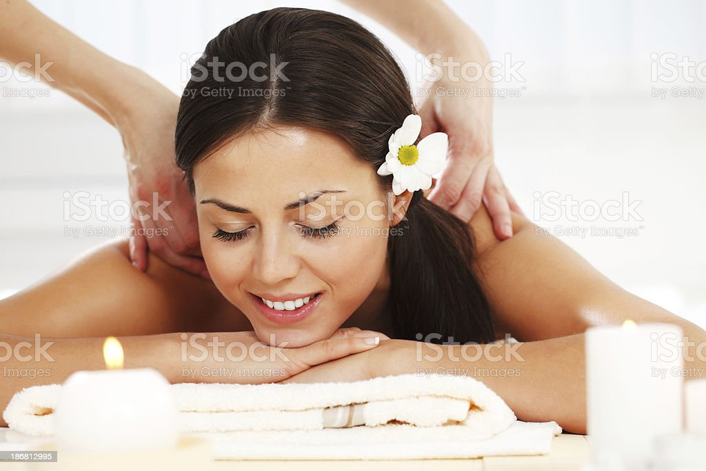 Beautiful brunette receiving a back massage. royalty-free stock photo