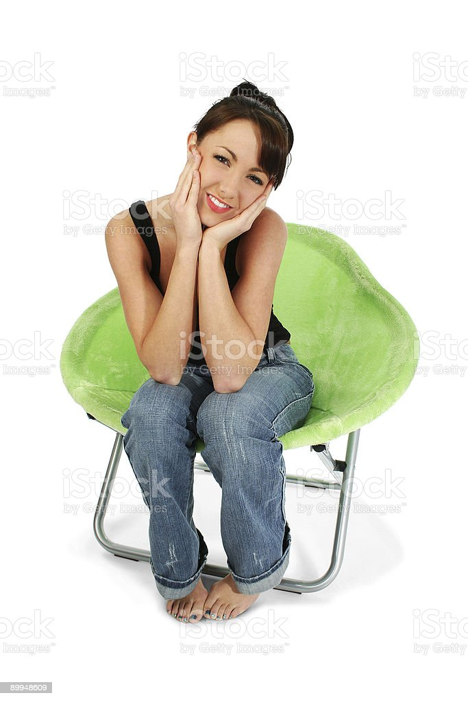 Beautiful Brunette Sitting in Chair royalty-free stock photo