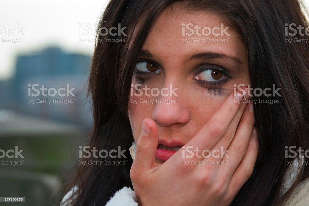 Beautiful Brunette Teenage Girl Crying Outside, Copy Space stock photo