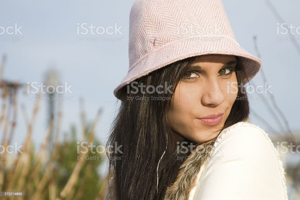Beautiful Brunette Teenage Young Woman Portrait in Tall Grass, Hat royalty-free stock photo