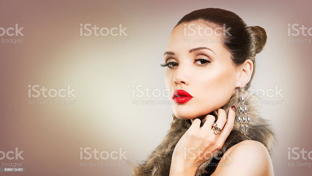 beautiful brunette with glamour earings and winter fur stock photo