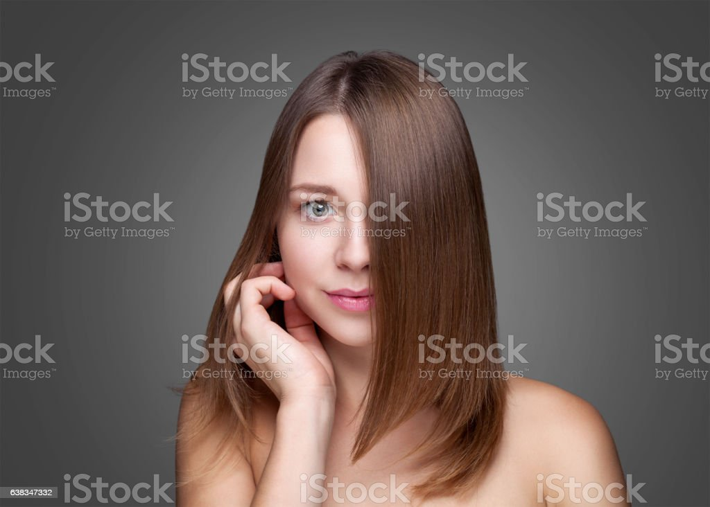 Beautiful brunette with long straight hair stock photo