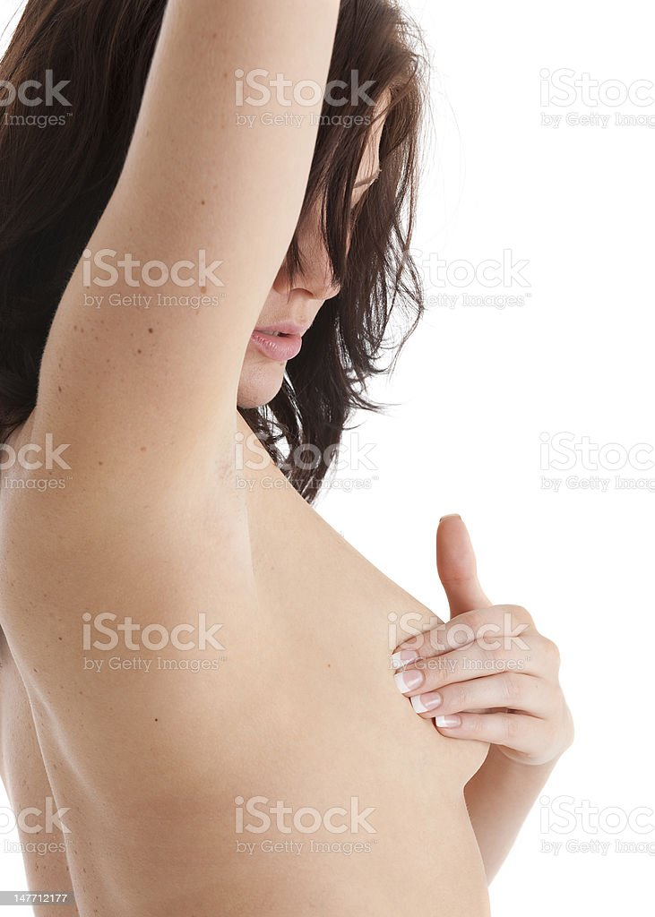 Beautiful brunette woman examining her breast for lumps royalty-free stock photo