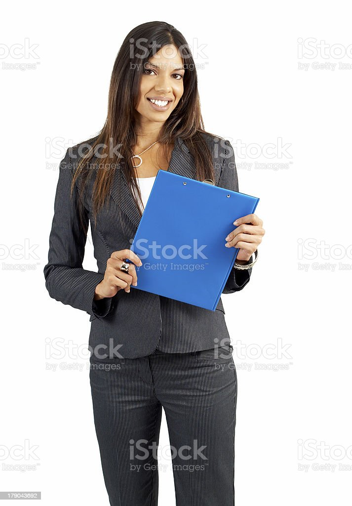 Beautiful brunette woman holding a clipboard royalty-free stock photo