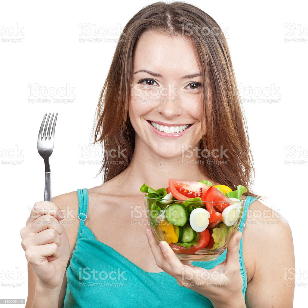Beautiful brunette woman holding plate of vegetable salad royalty-free stock photo