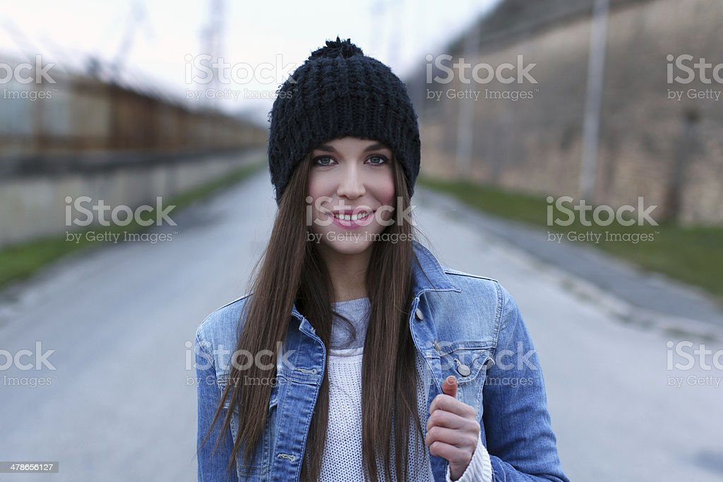Beautiful brunette woman in winter cap royalty-free stock photo