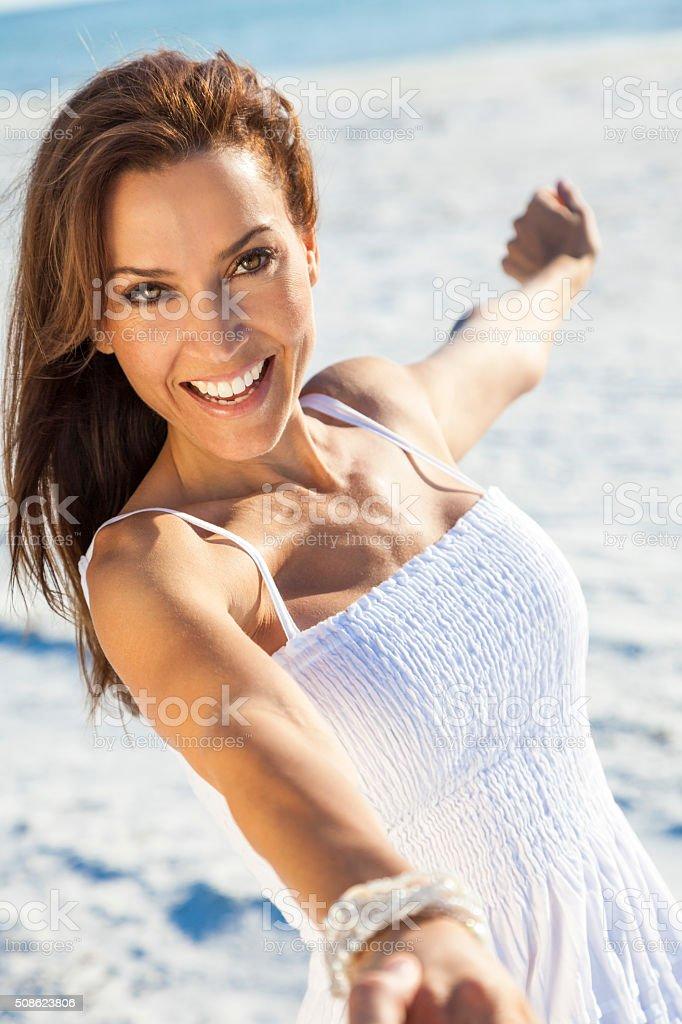 Beautiful Brunette Woman Laughing On A Beach stock photo