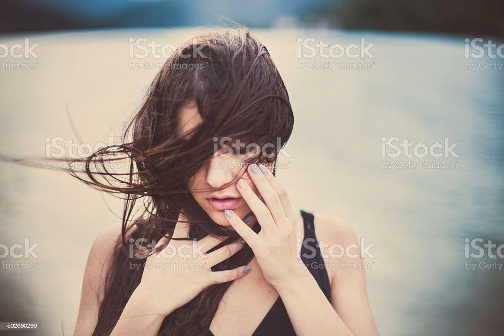 Beautiful brunette woman near lake portrait stock photo