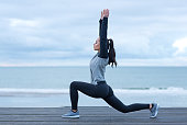 Beautiful brunette woman on a seafront wearing sports clothes