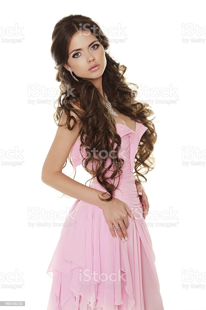 Beautiful brunette woman wearing in pink dress isolated on white royalty-free stock photo