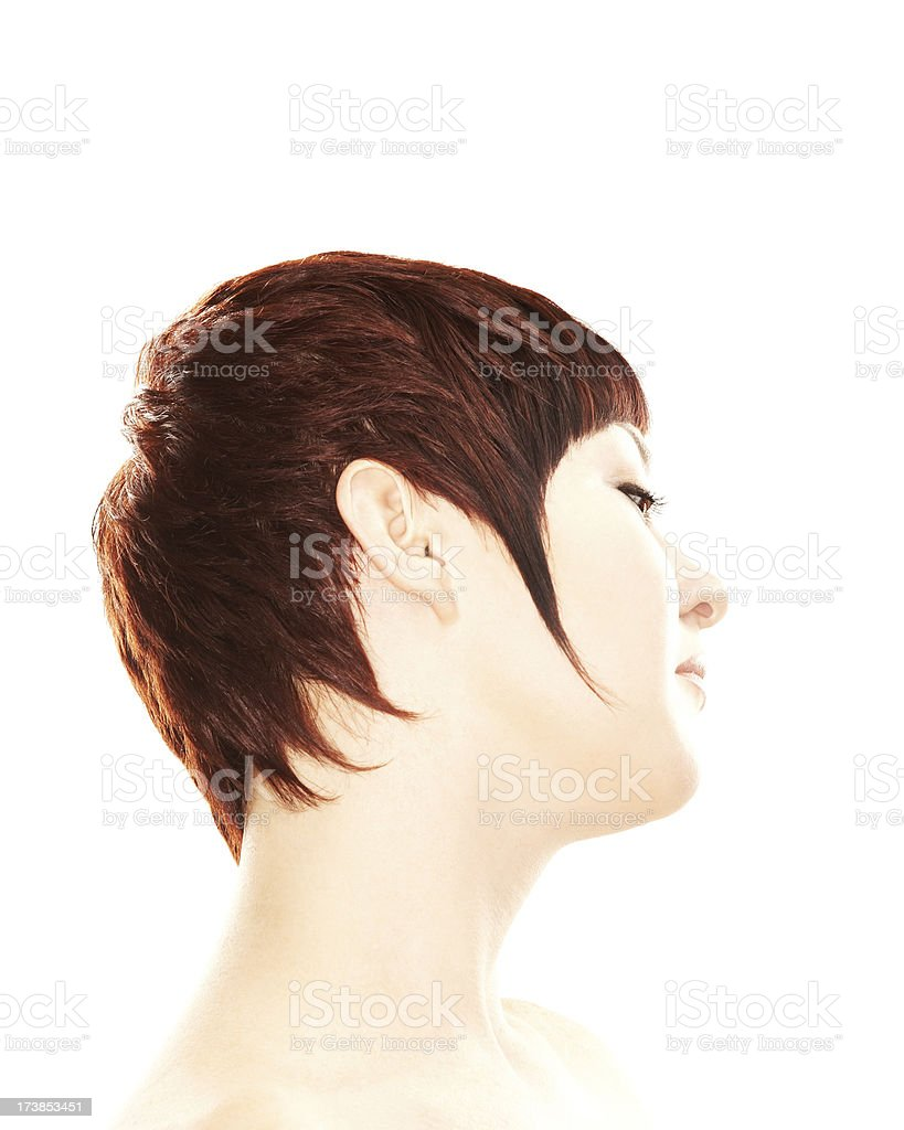 Beautiful brunette woman with a creative short hairstyle royalty-free stock photo