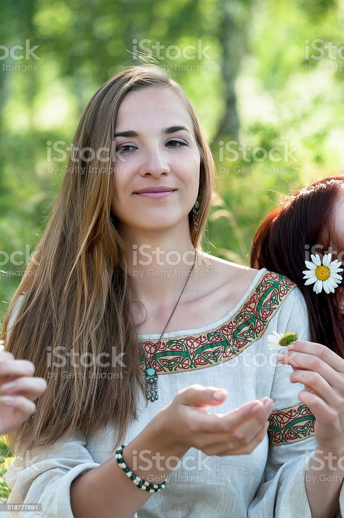Beautiful brunette woman with camomile stock photo