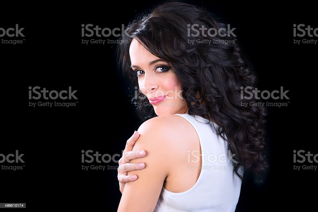 Beautiful brunette  woman with curly hair stock photo