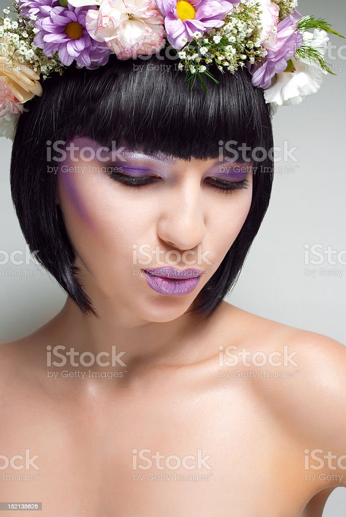 Beautiful brunette woman with flowers on head royalty-free stock photo