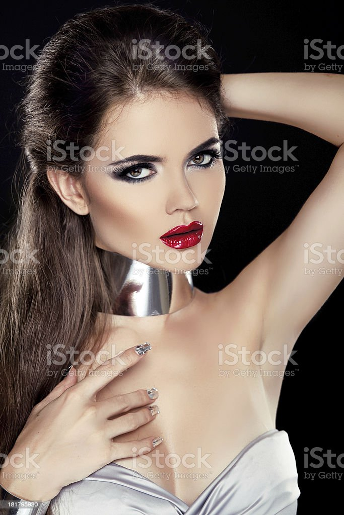 Beautiful Brunette Woman with Red lips isolated on black royalty-free stock photo
