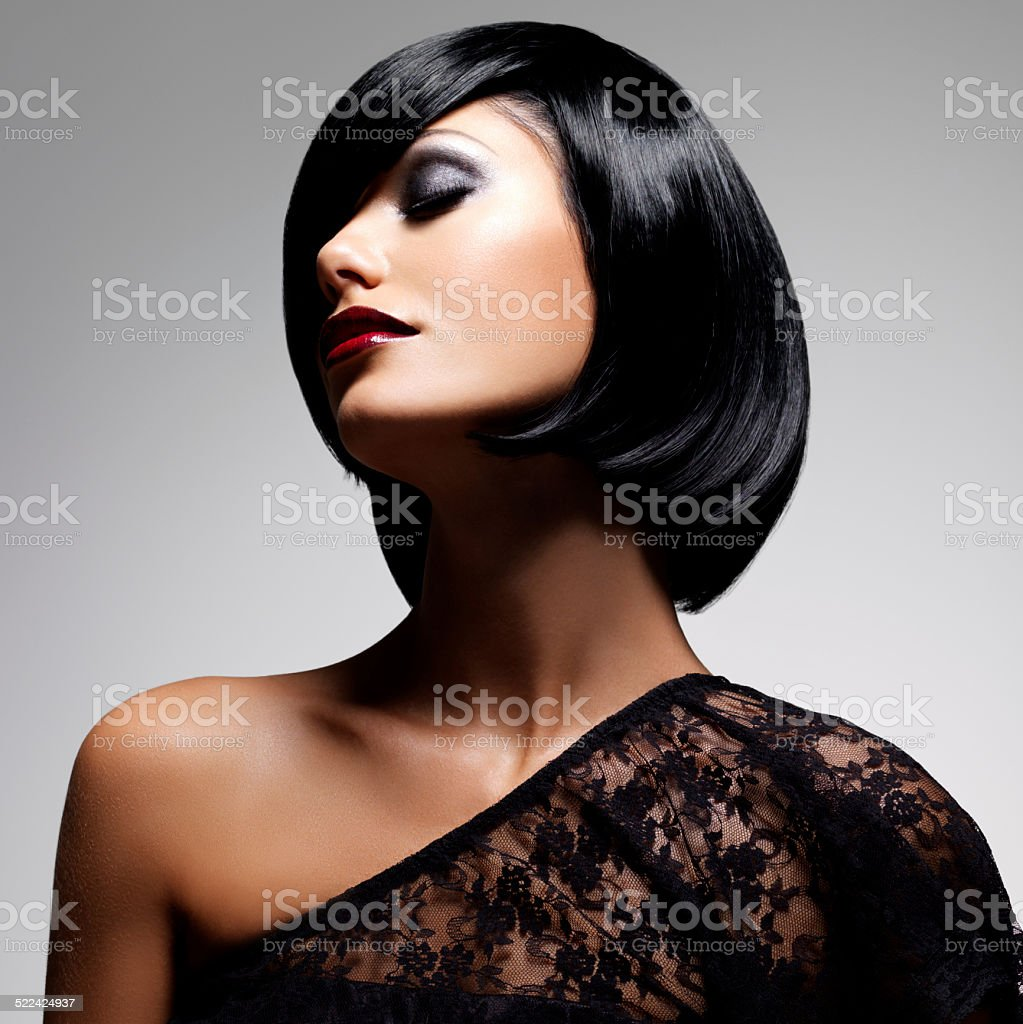 Beautiful brunette woman with shot hairstyle stock photo