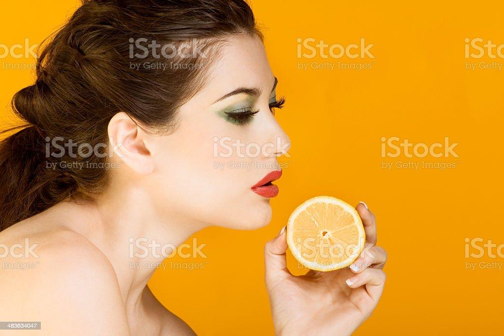 Beautiful brunette woman with slice of lemon royalty-free stock photo