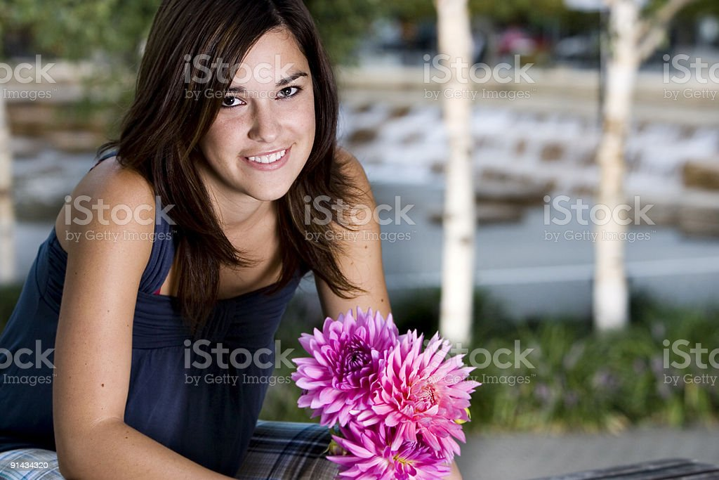 Beautiful Brunette Young Woman Holding Flowers Outside, Copy Space royalty-free stock photo