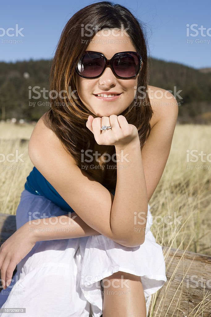 Beautiful Brunette Young Woman Portrait in Sunglasses at Sunny Beach royalty-free stock photo