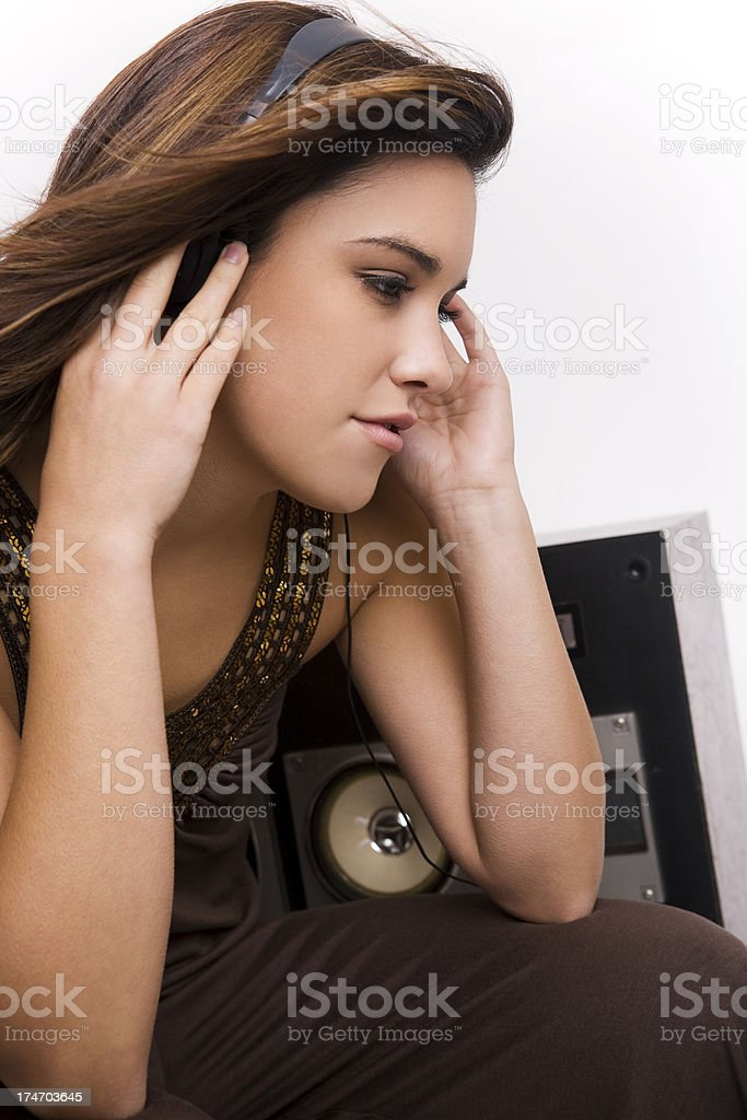 Beautiful Brunette Young Woman Smiling Listening to Music with Headphones royalty-free stock photo