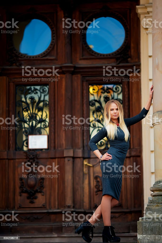 Beautiful brunette young woman wearing fashionable clothes, royalty-free stock photo