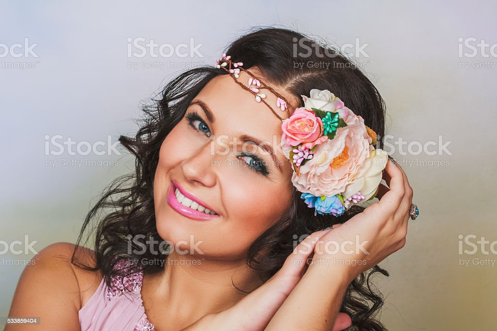 Beautiful brunnet woman with flower wreath stock photo
