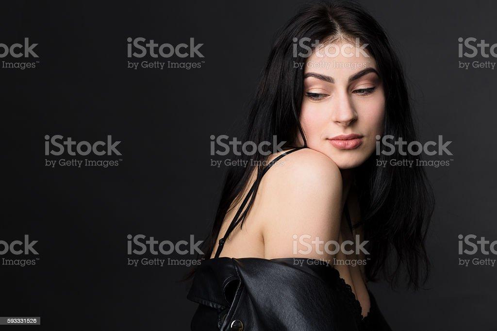 Beautiful brunnette model woman posing in studio stock photo