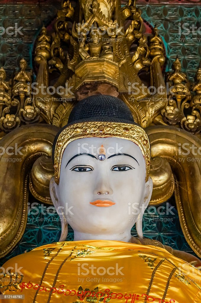beautiful Buddha Portrait with prominent 3rd eye and orange lips stock photo