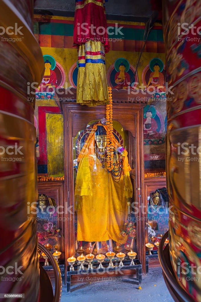 Beautiful buddha statue and prayer wheel stock photo