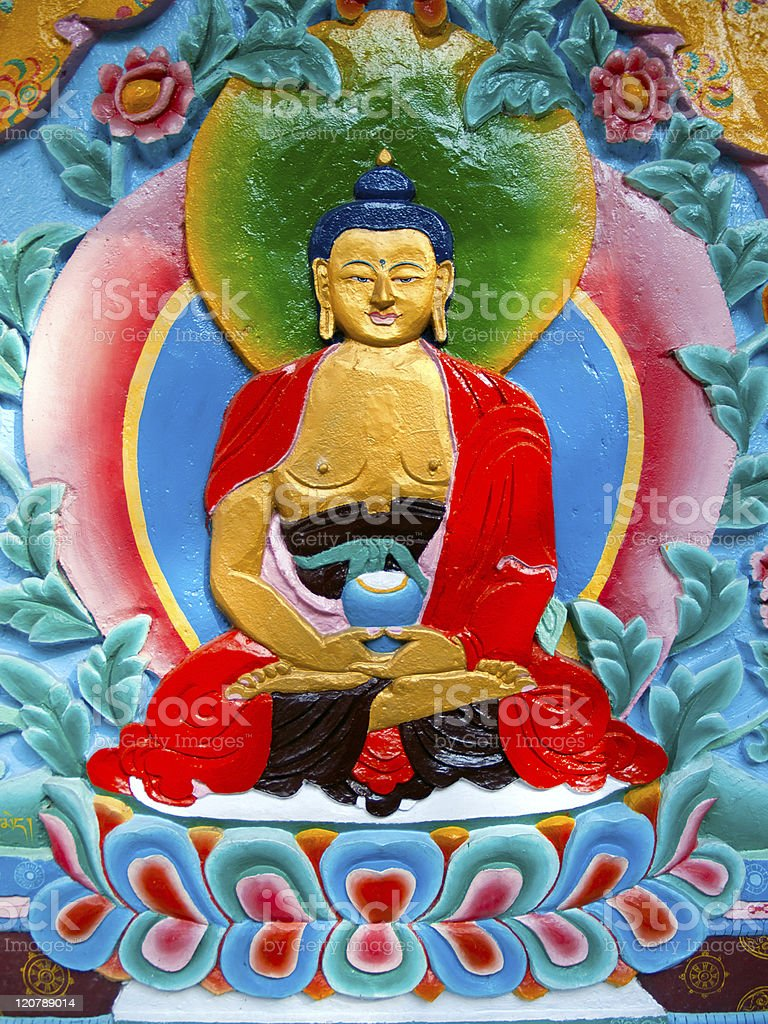 Beautiful buddhistic artwork on the wall of a temple stock photo