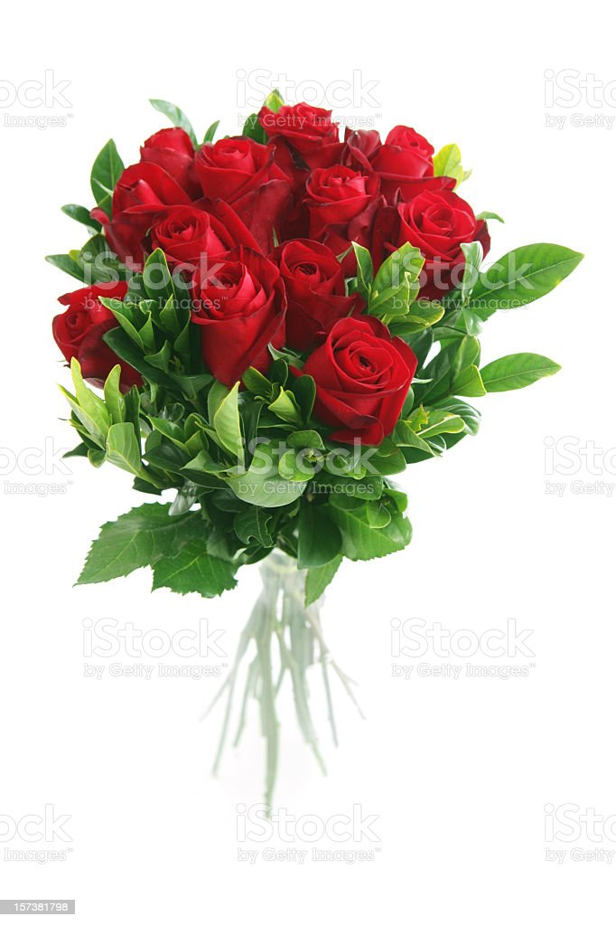 A beautiful bunch of red roses placed in a clear vase stock photo