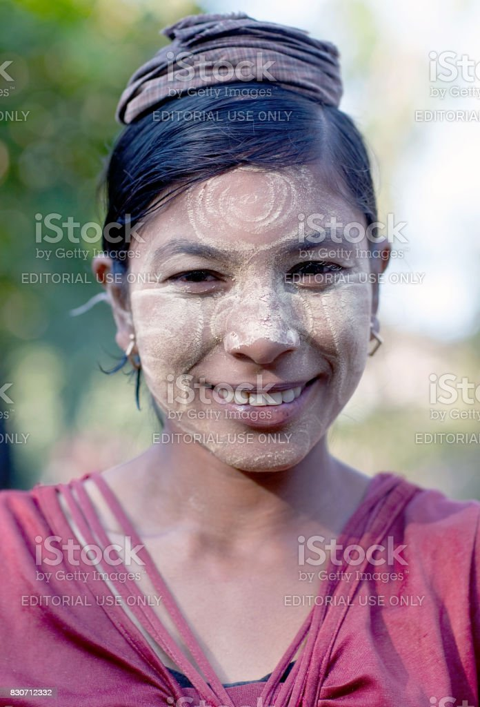 Beautiful Burmese girl with thanaka paste on her face stock photo