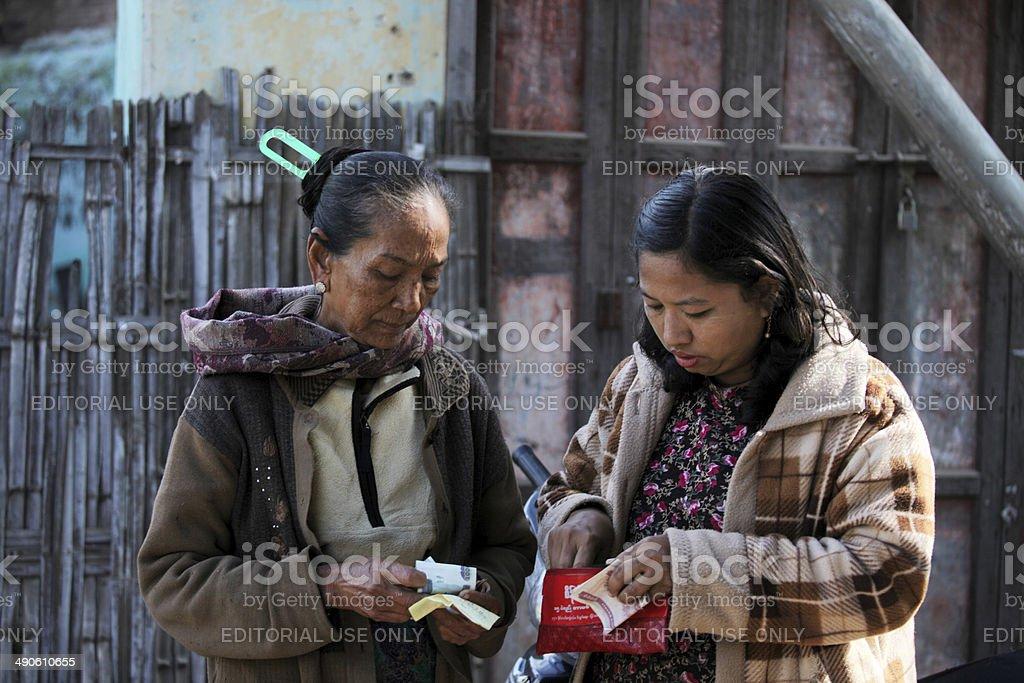 Beautiful Burmese women exchange money stock photo
