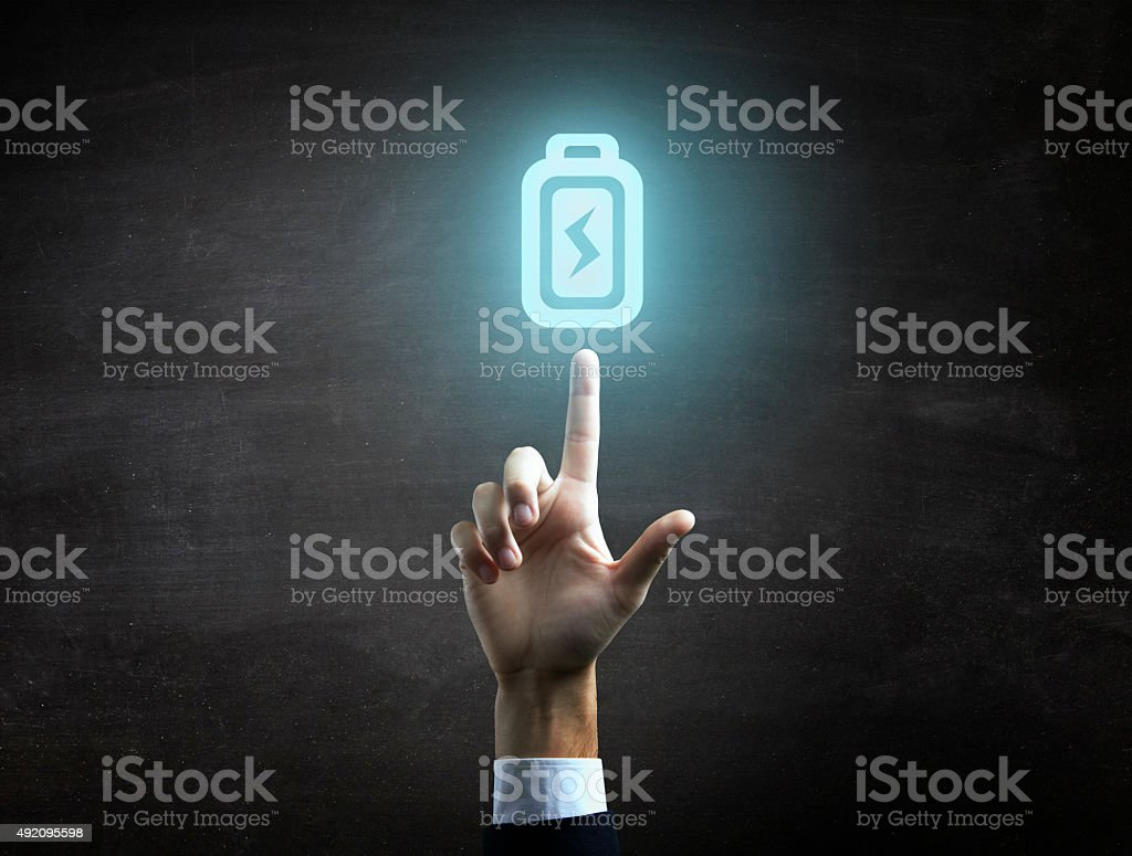 beautiful Business male hand indicating battery icon stock photo