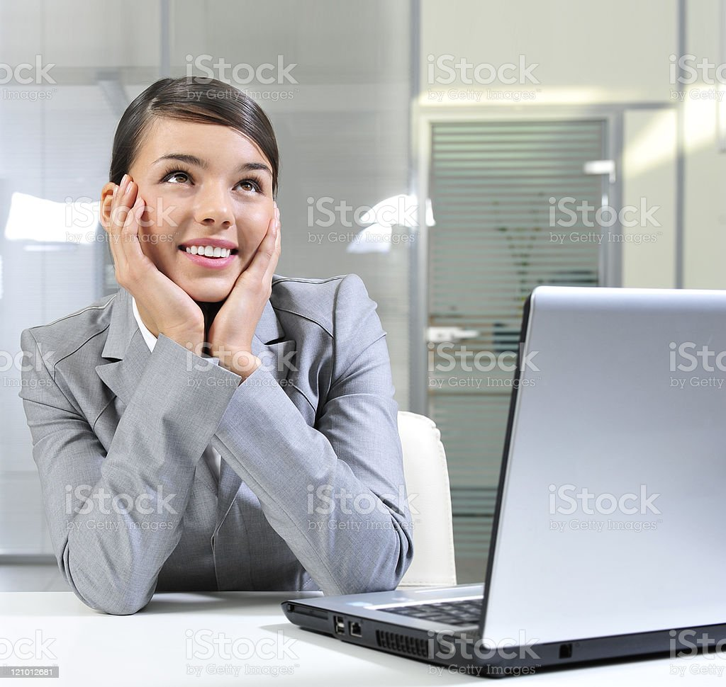 Beautiful business woman dreaming and looking up royalty-free stock photo