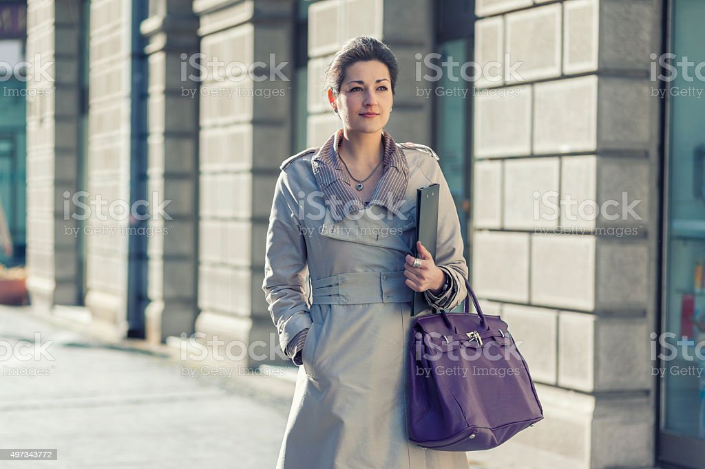 Beautiful business woman in the city stock photo