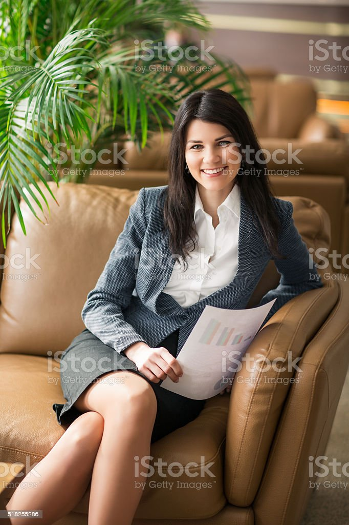 Beautiful business woman in the office. stock photo
