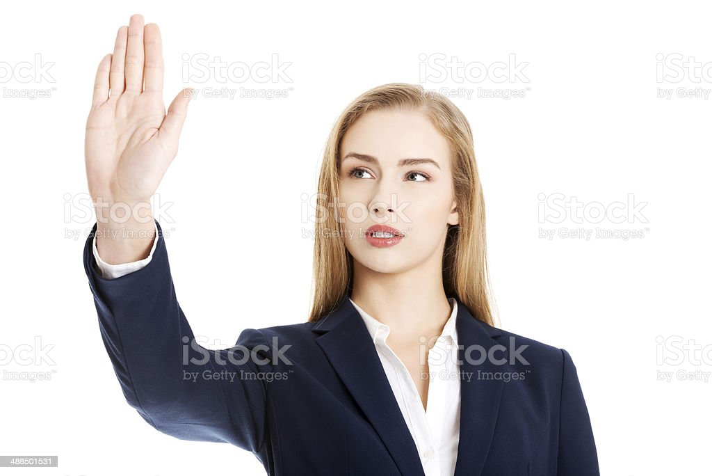 Beautiful business woman is having had up showing stop gesture. stock photo