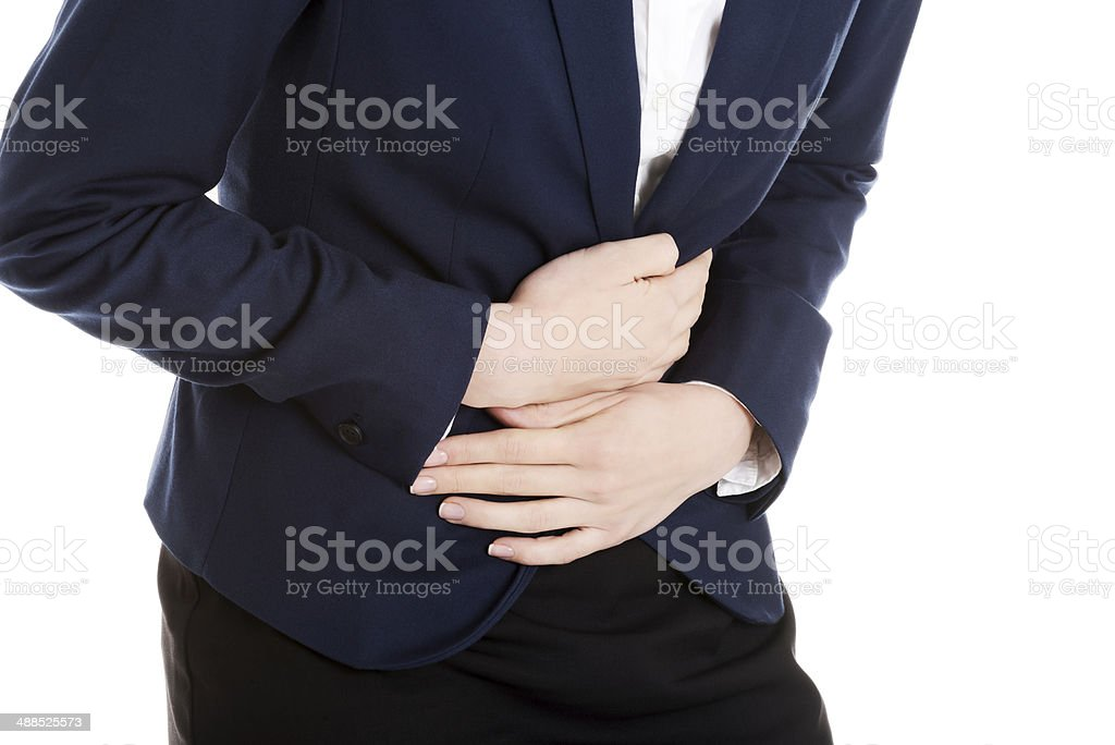 Beautiful business woman is touching her stomach. stock photo