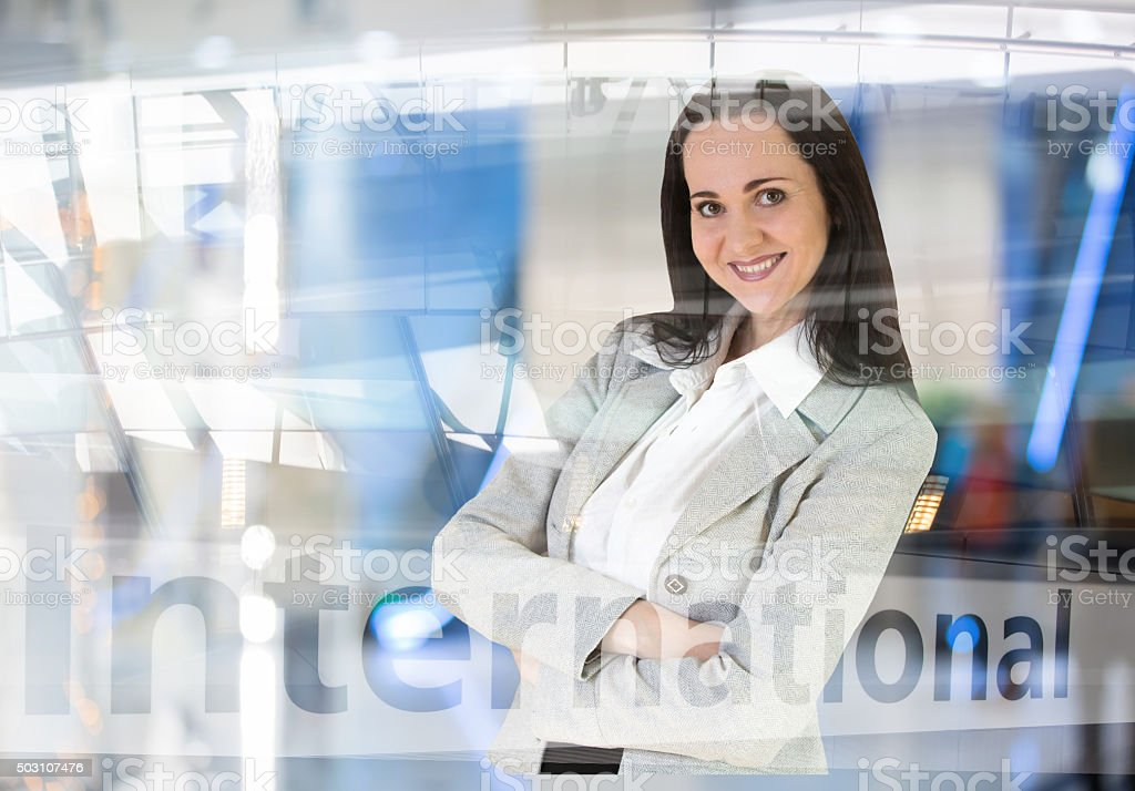 Beautiful business woman portrait in airport interior stock photo