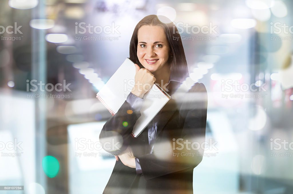 Beautiful business woman portrait in office against of glass reflection stock photo