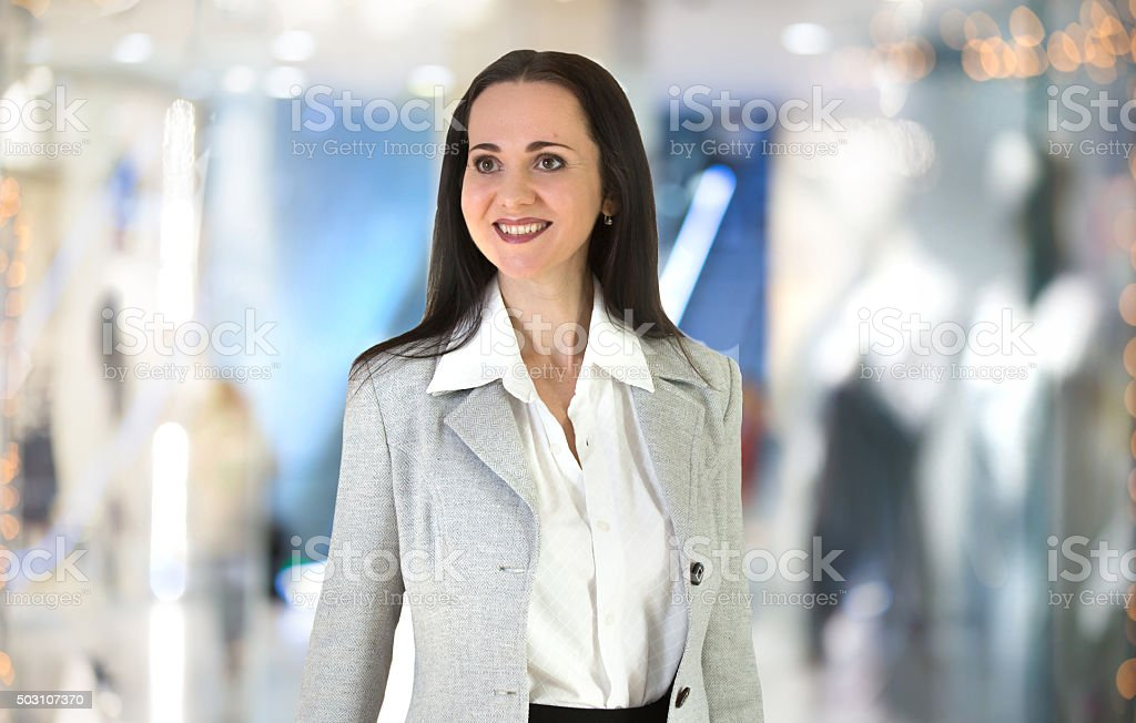 Beautiful business woman portrait walking in the office stock photo