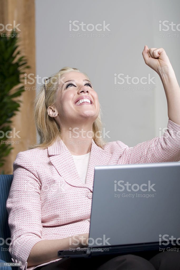 Beautiful Business Woman Pumping Fist in Air, Using Laptop royalty-free stock photo