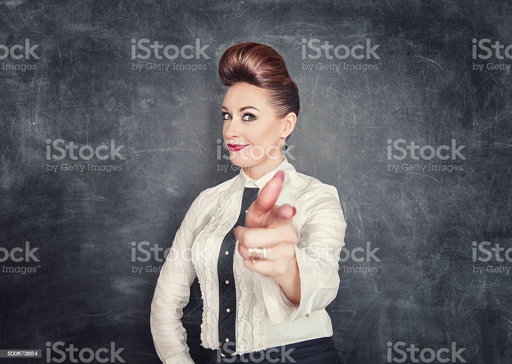 Beautiful business woman showing gun sign stock photo