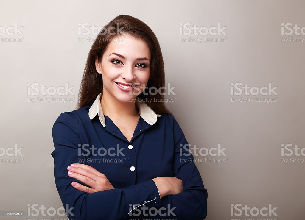 Beautiful business woman standing on grey background stock photo