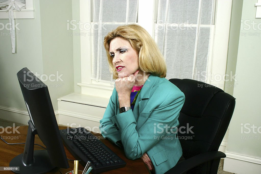 Beautiful Business Woman Thinking and Looking At Computer royalty-free stock photo