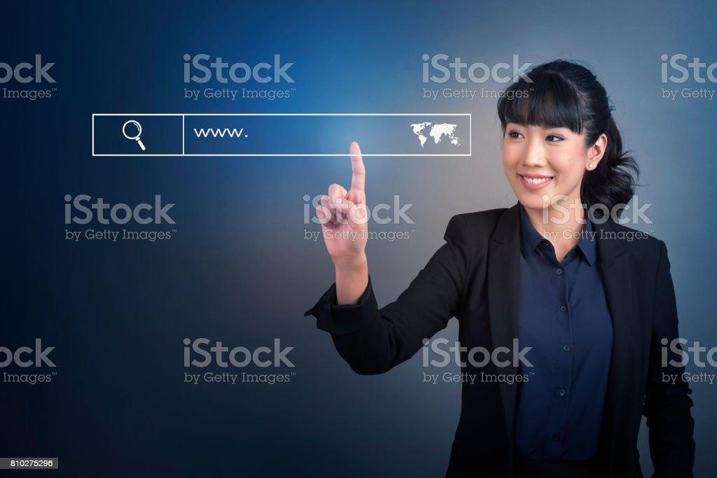 Beautiful Business Woman touching web search bottom sign on virtual screen stock photo