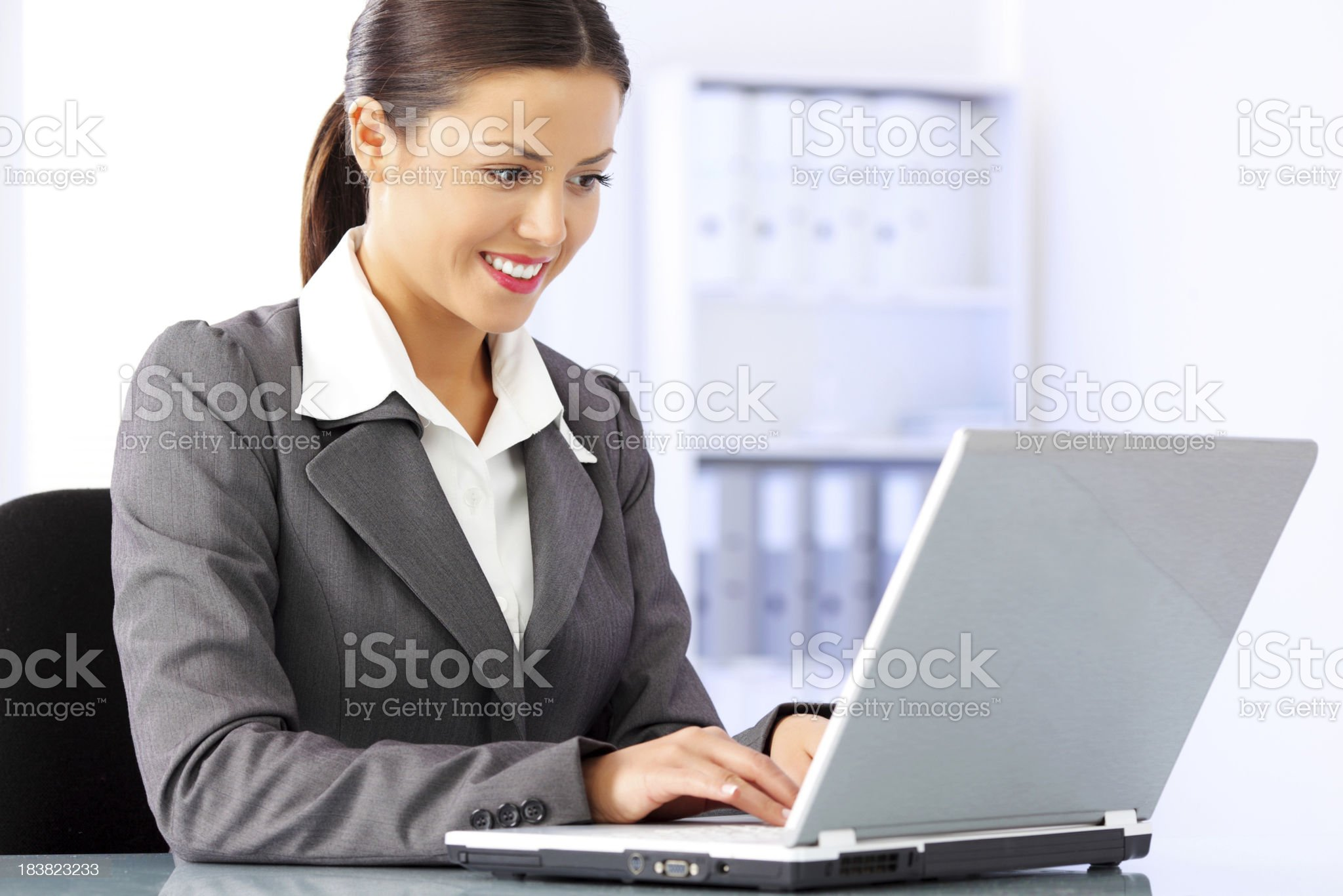 Beautiful business woman typing at laptop computer. royalty-free stock photo